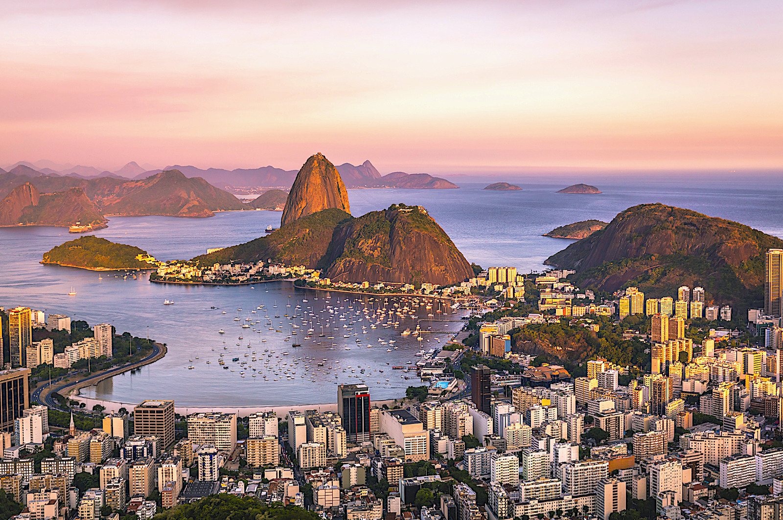 Sugarloaf Mountain (access via cable car) rises 400 meters over Rio de Janeiro